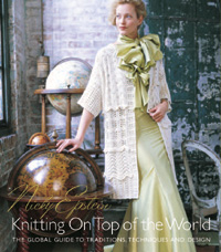 Knitting on top of the world cover